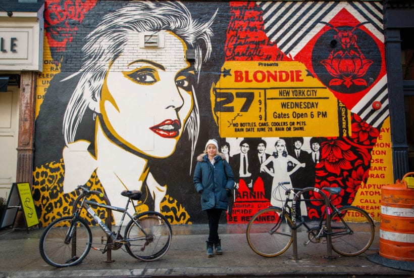 Amy Richards stands in front of street art in NYC | © Phil Provencio/Unearth Women