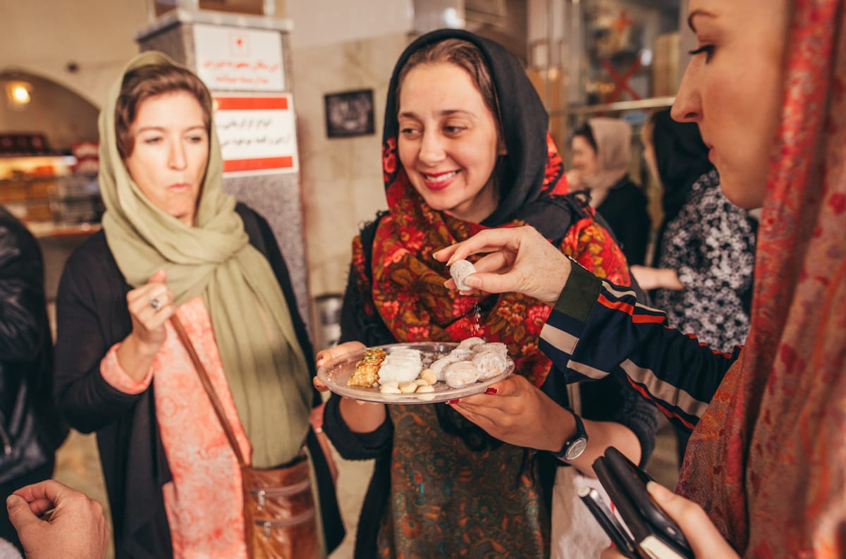 Nadia Badiee serves local treats to her tour © | Damian Raggatt/Intrepid Travel