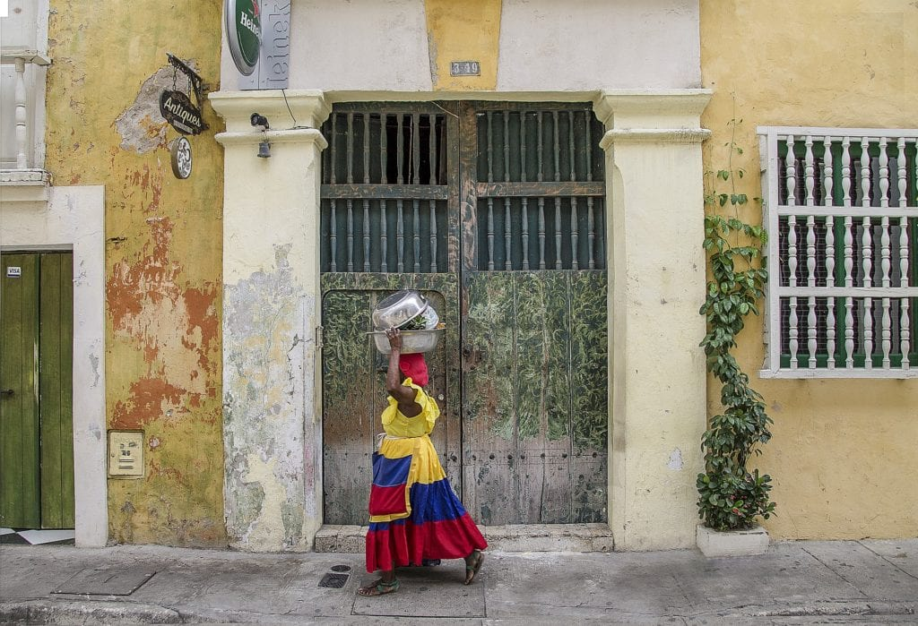 A local Colombian woman walks the streets of Cartagena © | ShonEjai/Pixabay