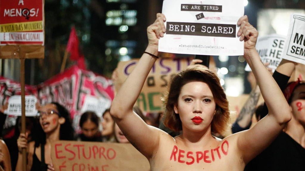 "Brazilian women protest against the country's ""machismo."" © 
