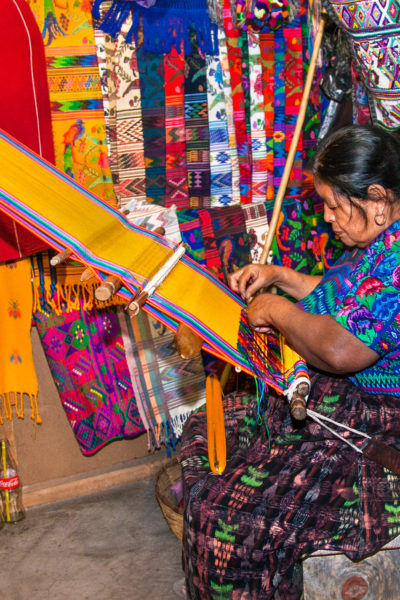 Mayan woman weaving with strap loom in Antigua, Guatemala | © Aleksandar Todorovic/Shutterstock