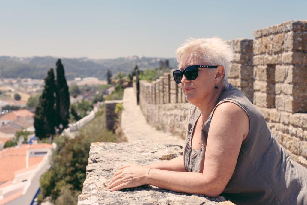 An older woman travel solo in Europe © | dabyki.nadya/Shutterstock