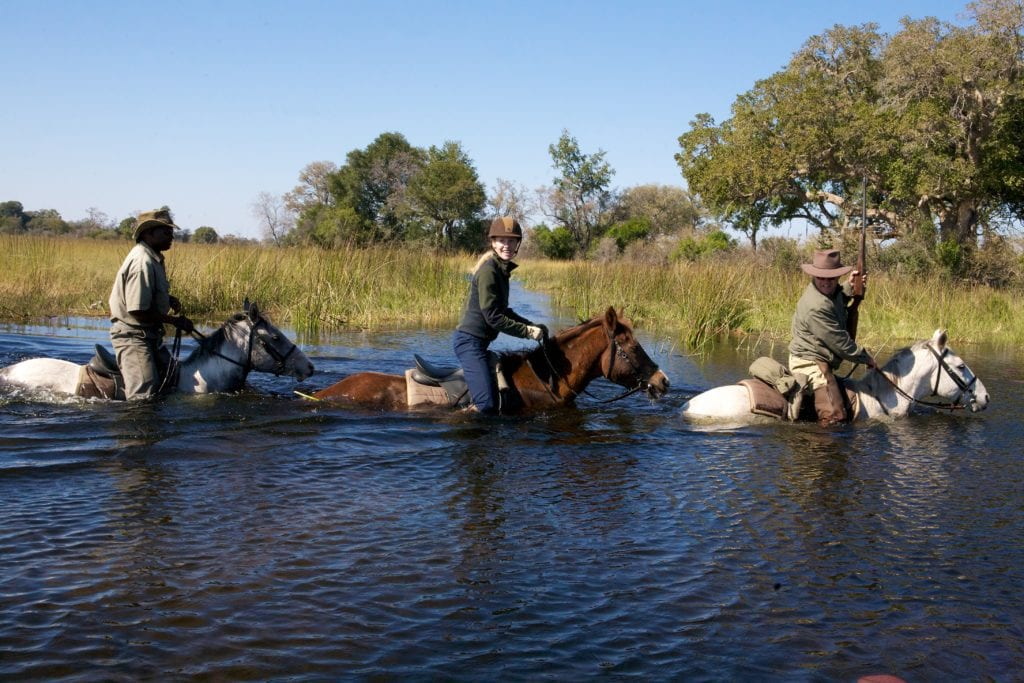 Horseback riding on Botswana's Okavango Delta | © Travels with Darley