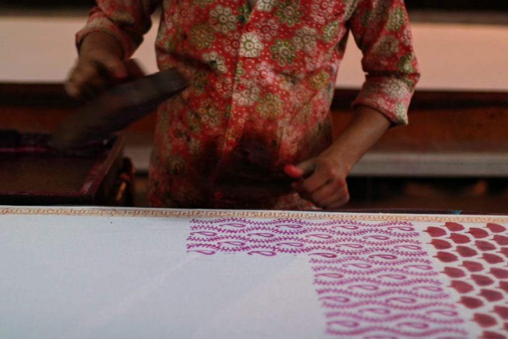 A worker block-prints in a factory outside of Jaipur | Photo by Jenna Kunze