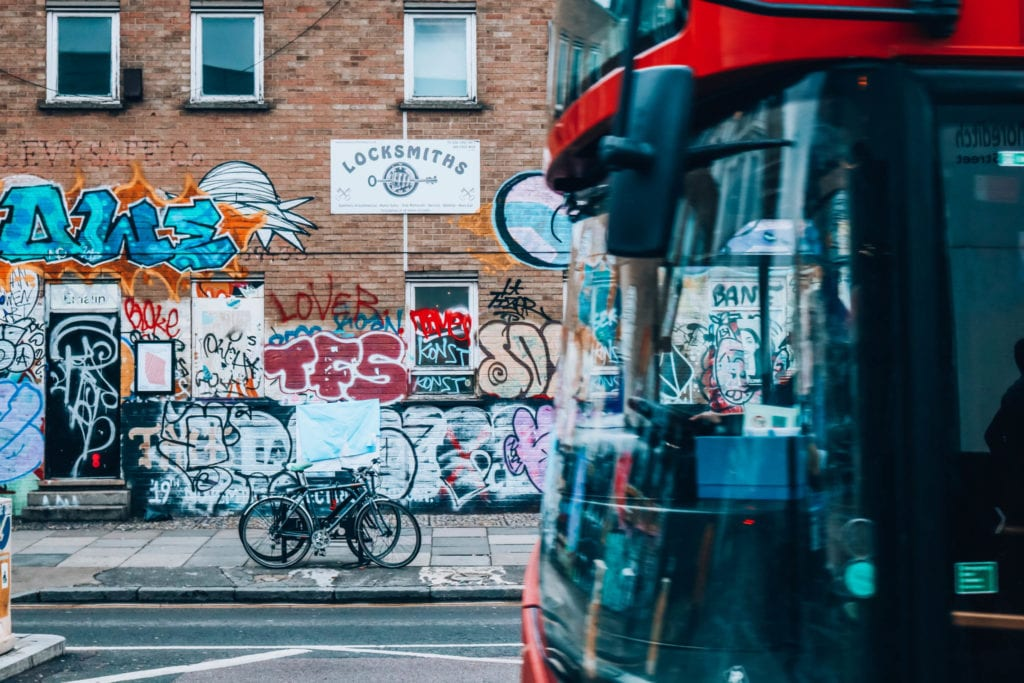 A bus passed by the street art of London | © Alex Saint