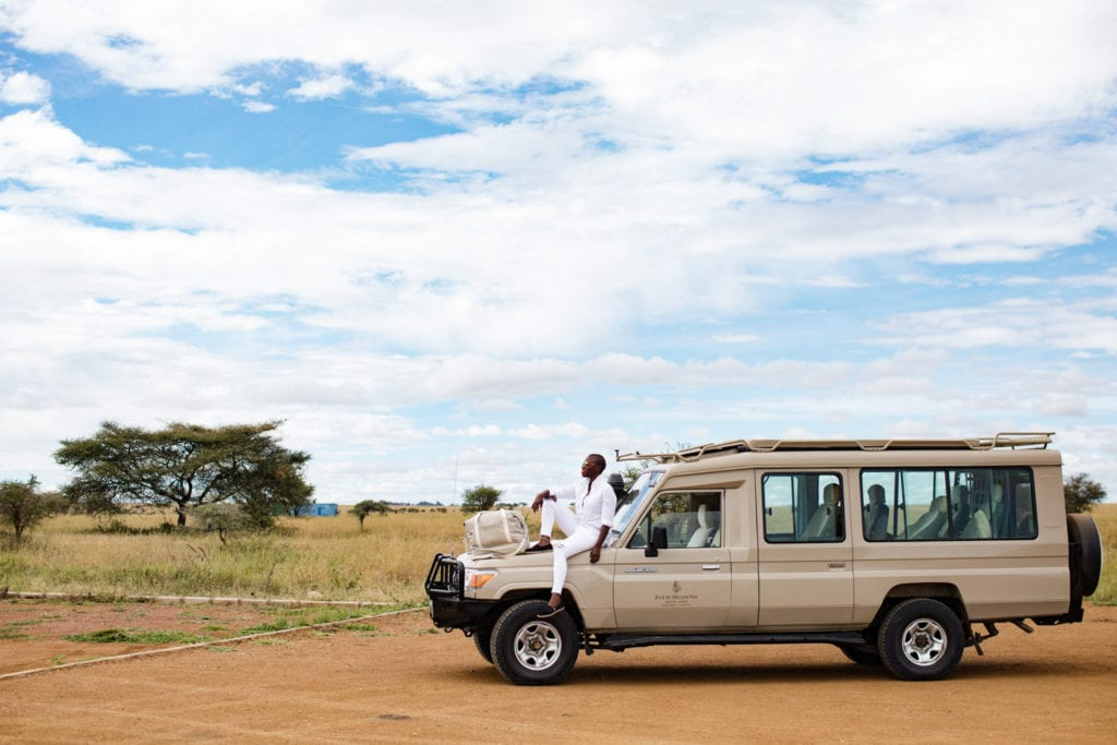 Jessica Nabongo in the Serengeti in Tanzania | © Elton Anderson