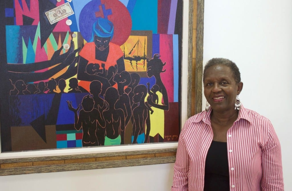 "Gallery owner Stella Jones with ""Haiti Demain,"" 1987 (mixed-media collage on canvas) by Lois Mailou Jones. 
