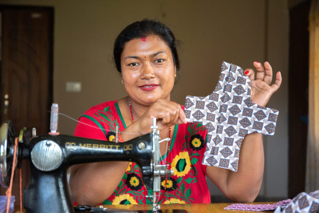 Sangita, 32, holds up a finished reusable sanitary pad | © WaterAid/ Mani Karmacharya