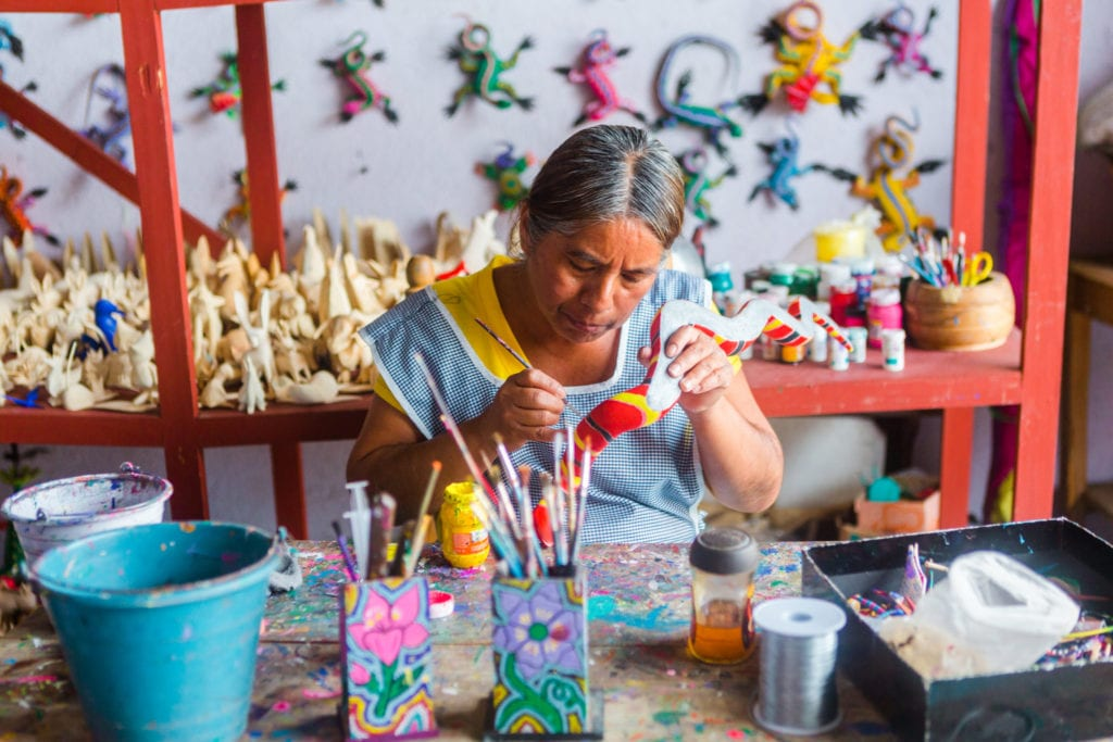 Artists of the woodcarving artisan village of San Martin Tilcajete in Oaxaca | © Kelli Hayden / Shutterstock