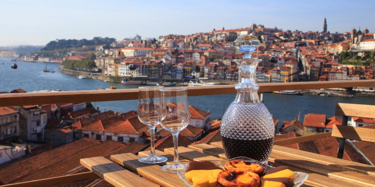 Wine glasses with a view of Porto, Portugal   © Diana Rui/Shutterstock