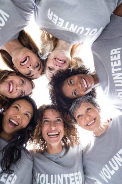 A group of female volunteers pose for a photo | © Shutterstock