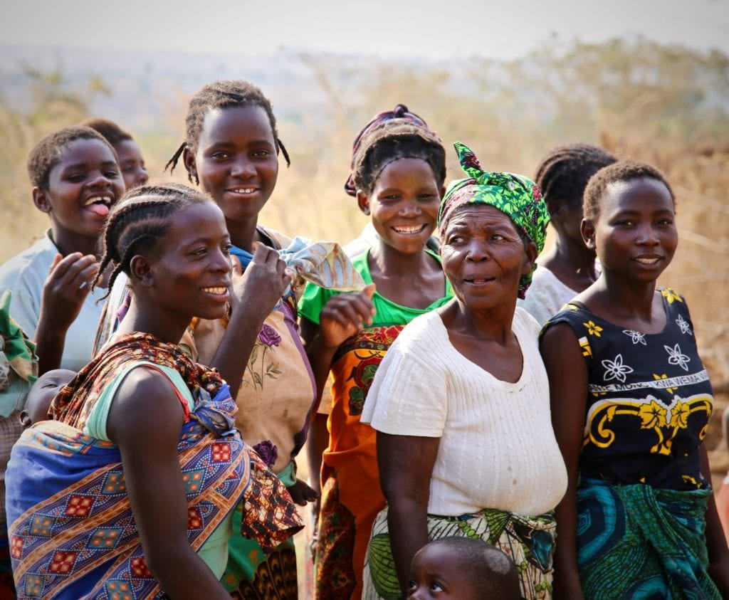 Women and girls post for a photo in a village in Malawi | © Oxford Media Library / Shutterstock