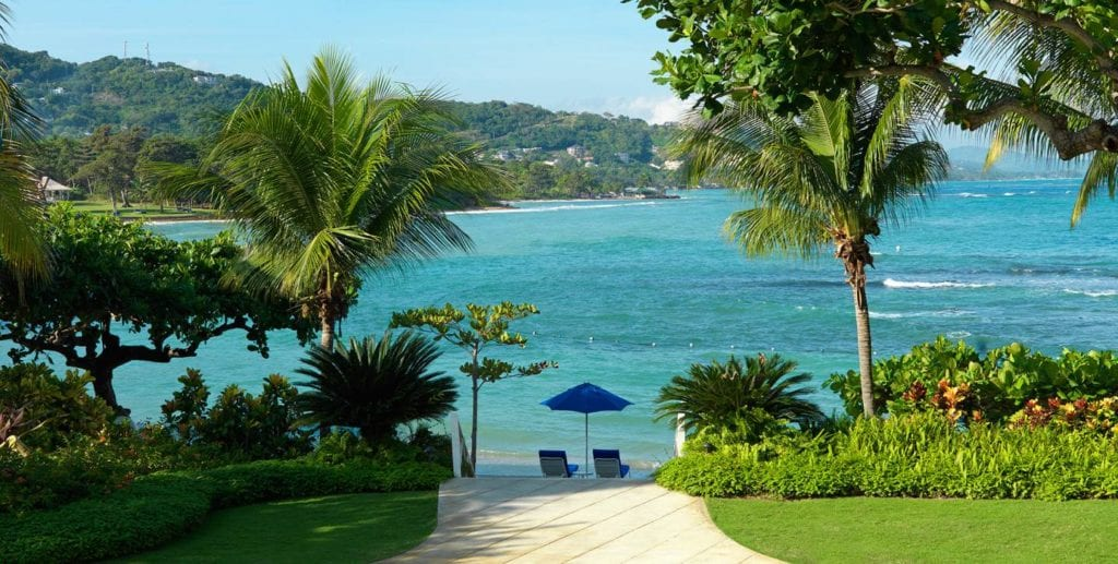 A path leads to the private beach at Round Hill Resort in Jamaica | © Courtesy of Round Hill Resort