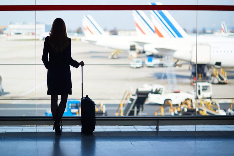 A woman's silhouette stands in front of a window at the airport | © Ekaterina Pokrovsky/Shutterstock