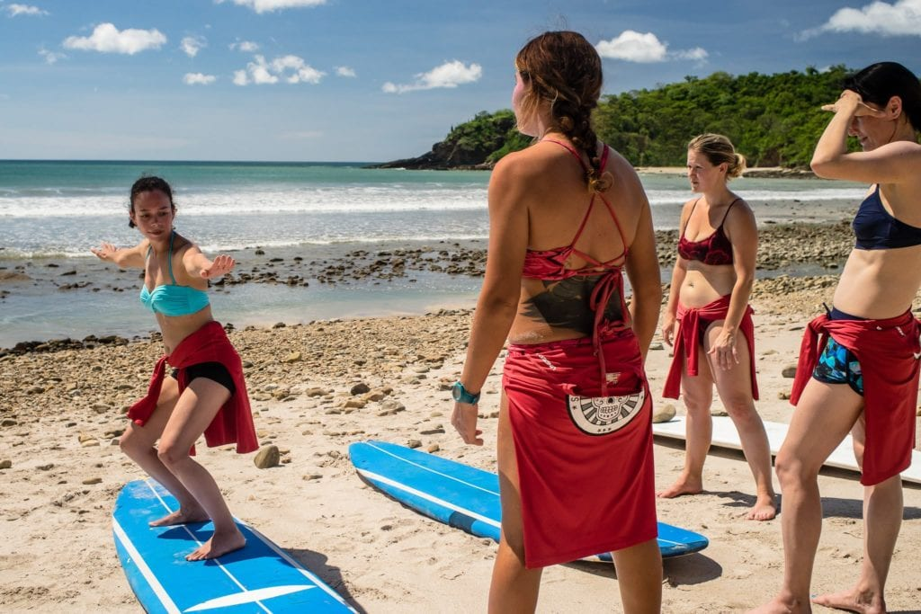 Travelers learning surfing in San Juan del Sur  | © Courtesy of Traverse Journey's Facebook Page, Photo by Jim Hill