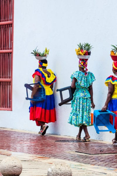 Local women walk the streets of Cartagena | © Anamaria Mejia/Shutterstock