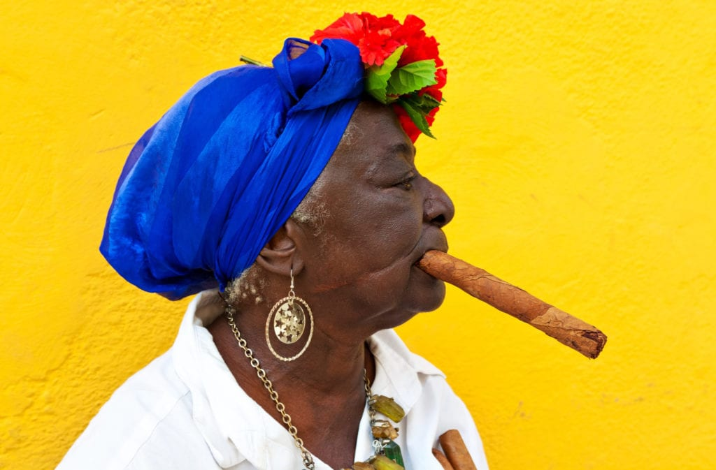 A local woman in Cuba poses with a Cuban cigar | © Kamira/Shutterstock