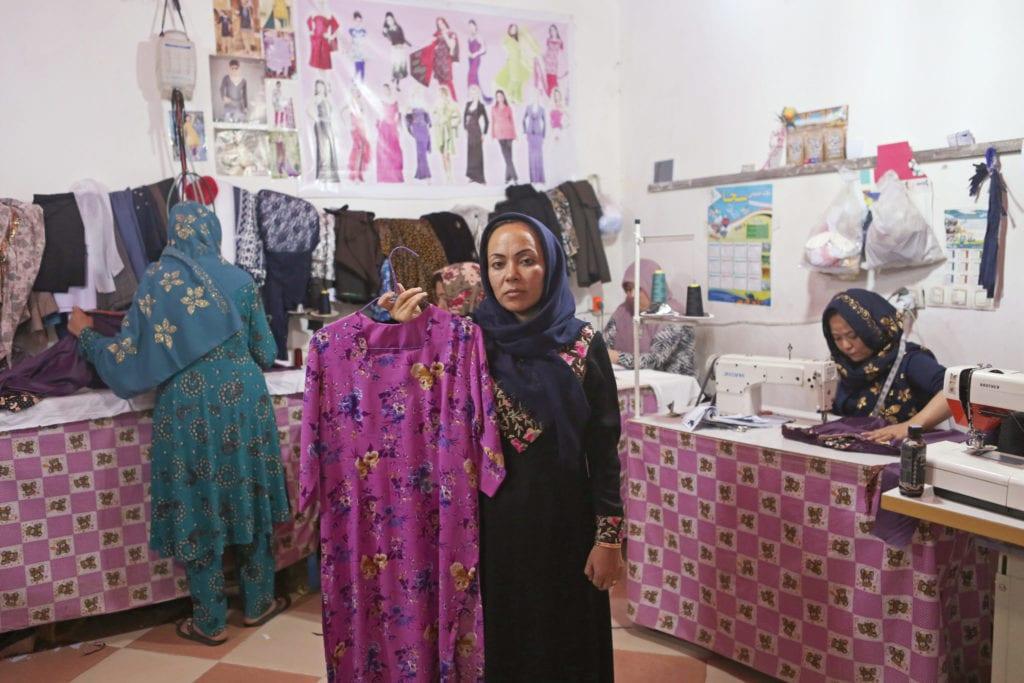Zarin (36) stands in her tailor shop in Kabul Afghanistan | © Rada Akbar/Women for Women International