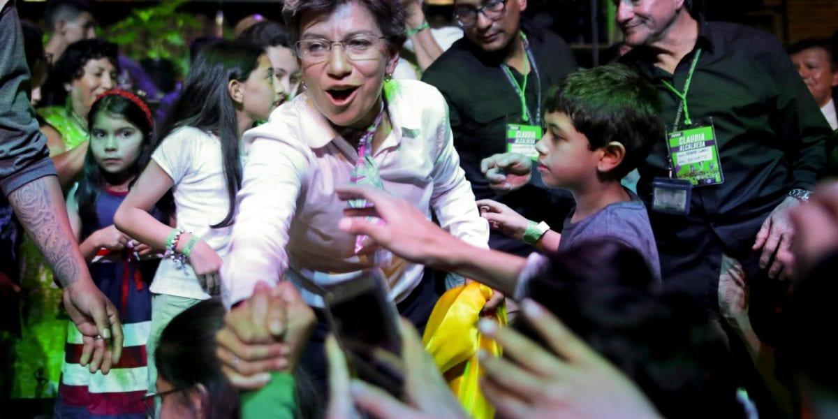 Claudia López celebrates her victory in winning Mayor | © Associated Press