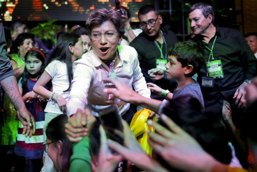 Claudia López celebrates her victory in winning Mayor | © Associated Press
