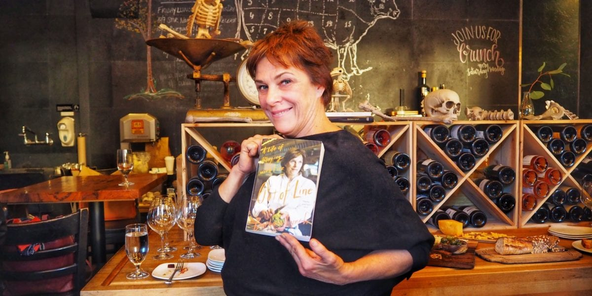 Chef Barbara Lynch poses with her new memoir | © Nikki Vargas/Unearth