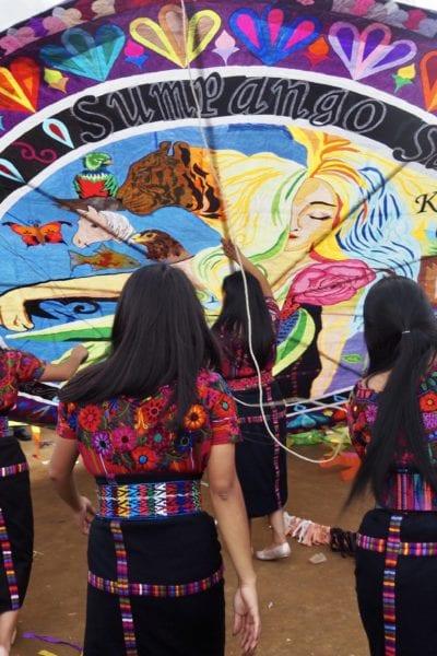 The Orquideas Oficial get ready to fly their handmade kite at Guatemala's kite festival in Sumpango | © Nikki Vargas/Unearth Women
