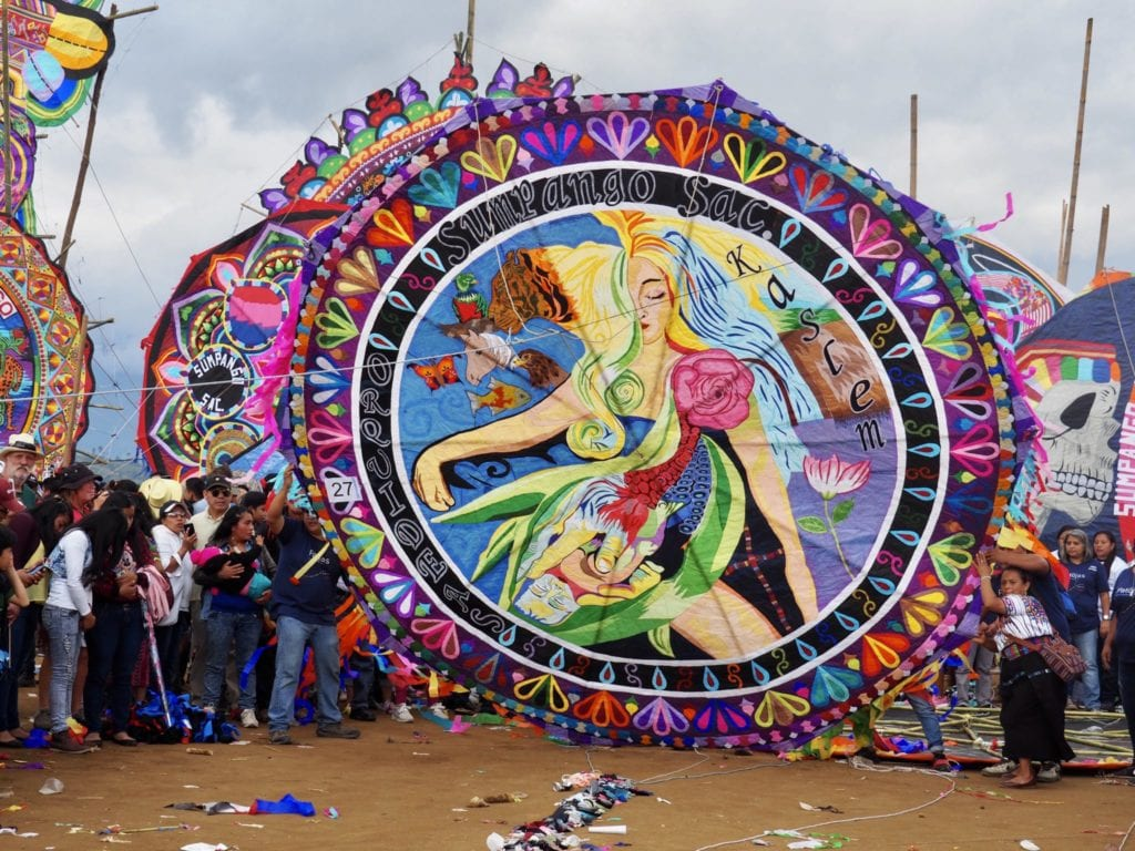 The Orquideas Oficial display their handmade kite at Guatemala's kite festival in Sumpango   © Nikki Vargas/Unearth Women
