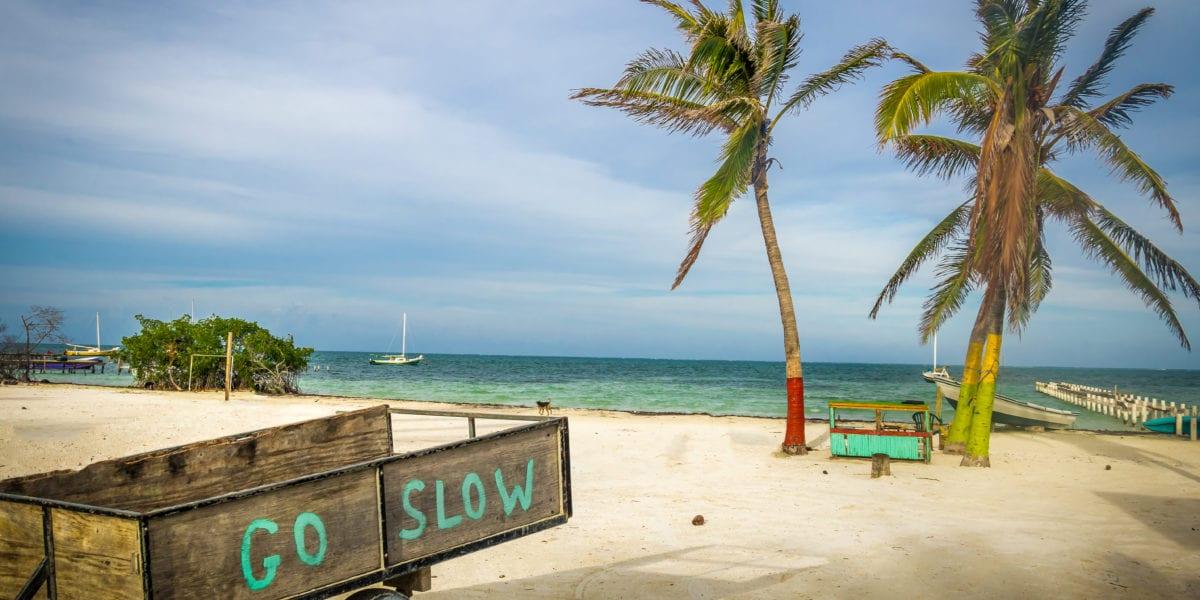 A wooden cart shares the Caye Caulker slogan: Go Slow | © Diego Grandi